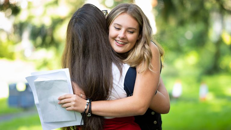 SWANSEA, WALES - AUGUST 20: Chloe Orrin hugs a friend after opening her GCSE results at Ffynone House school on August 20, 2020 in Swansea, Wales. GCSE students were unable to sit their exams this year due to the coronavirus pandemic. A government-backed algorithm used to award grades has been withdrawn after thousands of A level students were downgraded to the predicted grades given by teachers. This has caused many to lose out on university places. (Photo by Matthew Horwood/Getty Images)