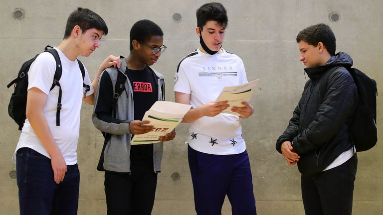Students discuss their GCSE results at Ark Evelyn Grace Academy, London.