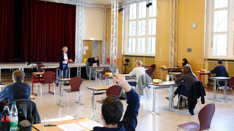 Students prepare to take an exam at the Gymnasium Steglitz school in Berlin