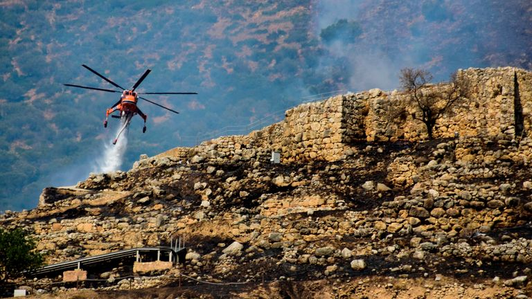 Firefighting helicopters were deployed to drop water over the archaeological site in Greece