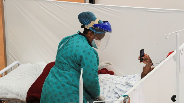 A health worker treats a patient at a temporary field hospital set up by Medecins Sans Frontieres (MSF) during the coronavirus disease (COVID-19) outbreak in Khayelitsha township near Cape Town, South Africa, July 21, 2020