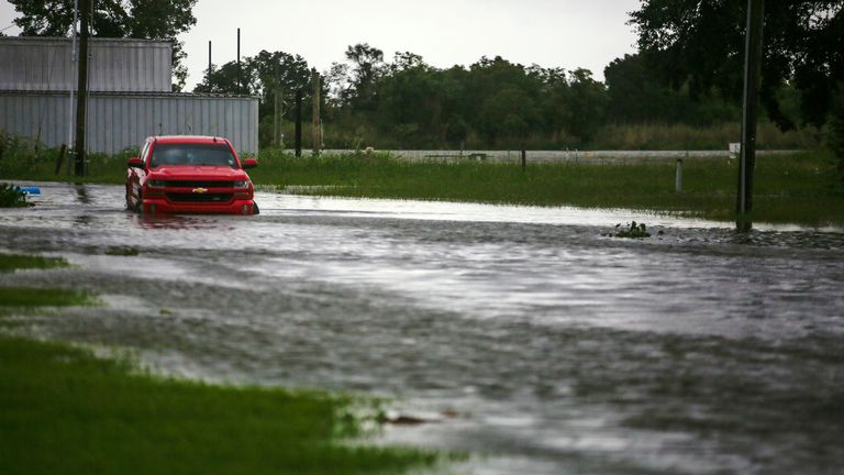 A car near Vermilion Bay, in southern Louisiana, partially submerged in waters brought by Hurricane Laura