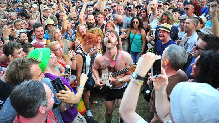 Idles' Mark Bowen gets into the crowd at Glastonbury in 2019