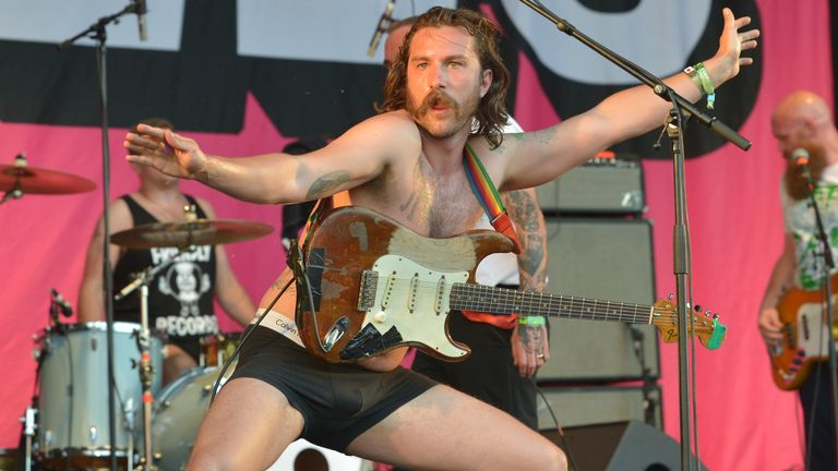 Idles' Mark Bowen on stage at Glastonbury in 2019
