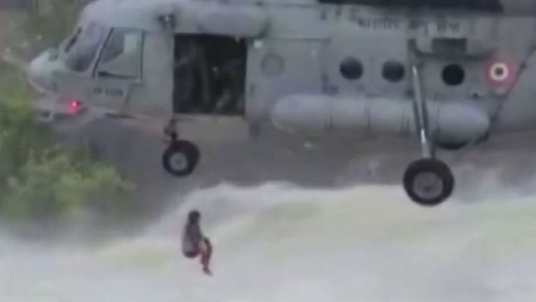 Man is rescued from overflowing dam in India