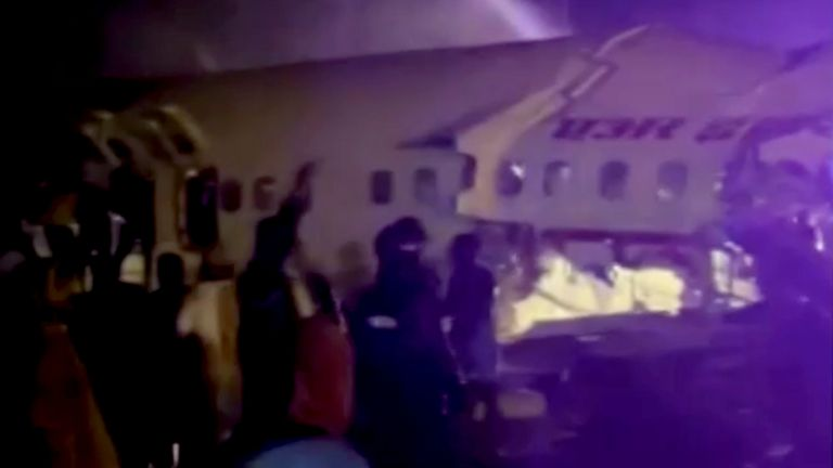 A passenger plane that crashed after it overshot the runway is seen at Calicut International Airport in Karipur, southern state of Kerala, India, August 7, 2020, in this still image obtained from a video. ANI/Reuters TV/via REUTERS NO RESALES. NO ARCHIVES. INDIA OUT.THIS IMAGE HAS BEEN SUPPLIED BY A THIRD PARTY.
