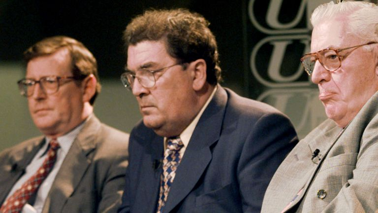 John Hume takes part in an interview after Northern Ireland votes in support of the peace deals signed on Good Friday