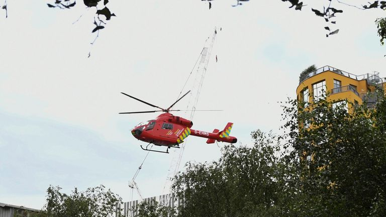 "A London Air Ambulance helicopter takes off from outside the Tate Modern gallery in London on August 4, 2019 after it was put on lock down and evacuated after an incident involving a child falling from height and being airlifted to hospital. - London's Tate Modern gallery was evacuated on Sunday after a child fell ""from a height"" and was airlifted to hospital. A teenager was arrested over the incident, police said, without giving any details of the child's condition. (Photo by Daniel SORABJI / A"