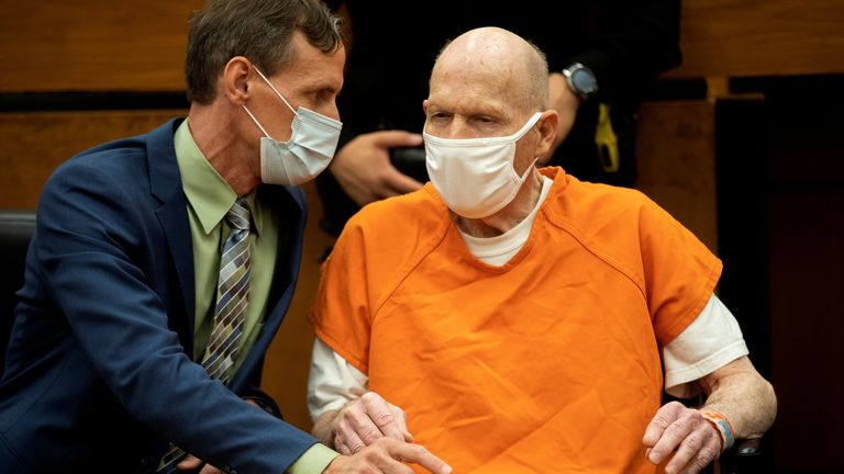 Joseph James DeAngelo (R), known as the Golden State Killer, speaks with public defender Joseph Cress