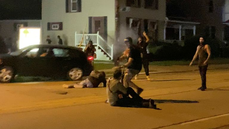 A man is shot in his arm during a protest following the police shooting of Jacob Blake in Kenosha, Wisconsin. Pic: Brendan Gutenschwager/Reuters