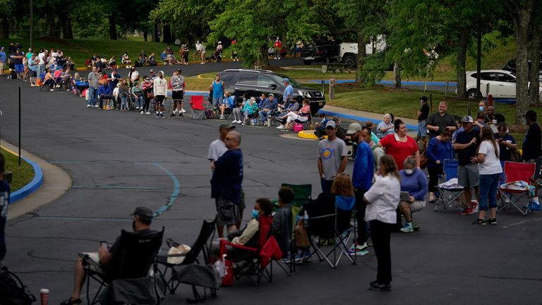 People line up outside Kentucky Career Center prior to its opening to find assistance with their unemployment claims in Frankfort, Kentucky, U.S. June 18, 2020. REUTERS/Bryan Woolston TPX IMAGES OF THE DAY