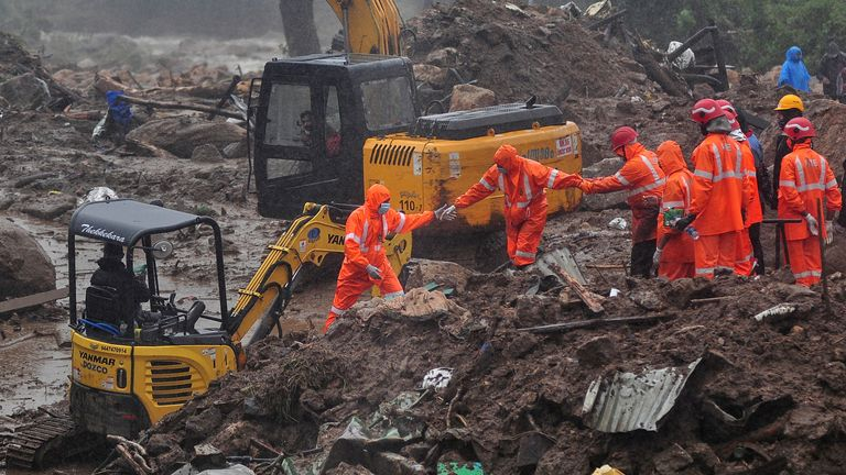 Rescue workers were struggling to dig through the debris as the heavy rain continued