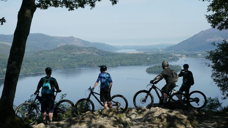 Cyclists stop to enjoy the view of Derwentwater in the Lake District
