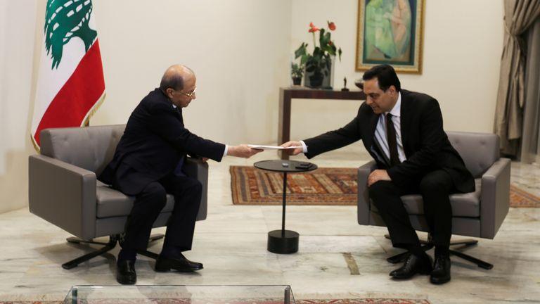 Lebanon's Prime Minister Hassan Diab submits his resignation to Lebanon's President Michel Aoun at the presidential palace in Baabda, Lebanon