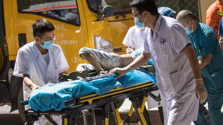 Medical workers carry an injured person out of the rubble of a collapsed restaurant in Linfen, in China's northern Shanxi province
