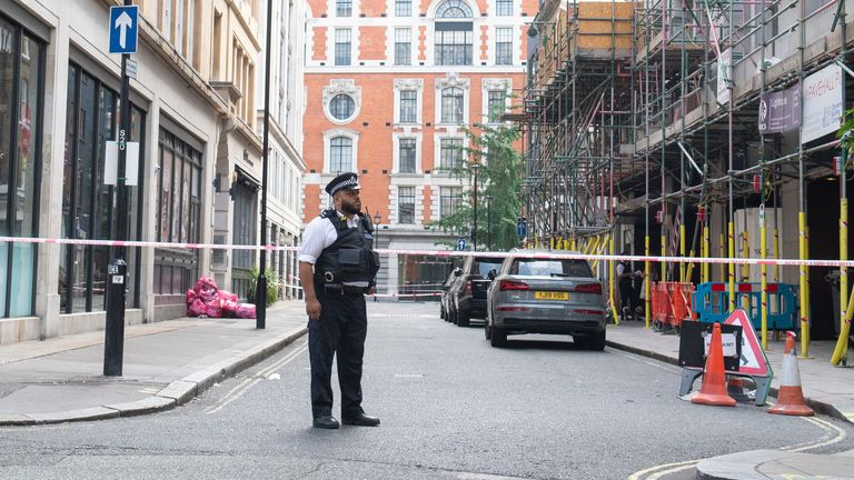 Police at a cordon on Market Place, off Oxford Street, where a teenager was stabbed on Saturday