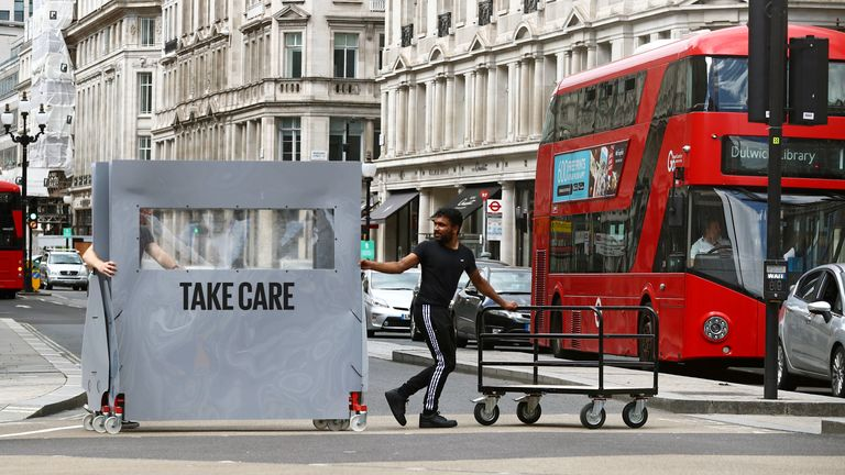 A store worker walks with an equipment, amid the spread of the coronavirus disease (COVID-19) in Oxford Street