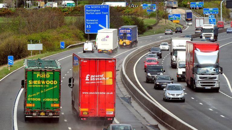 General view of HGV lorries on the M42 motorway.