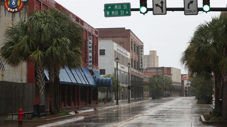 A main street in the business area of Lake Charles, Louisiana, is empty as people seek safe shelter