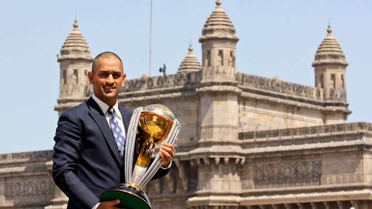 Dhoni poses with the  ICC Cricket World Cup Trophy after captaining India to victory in 2011