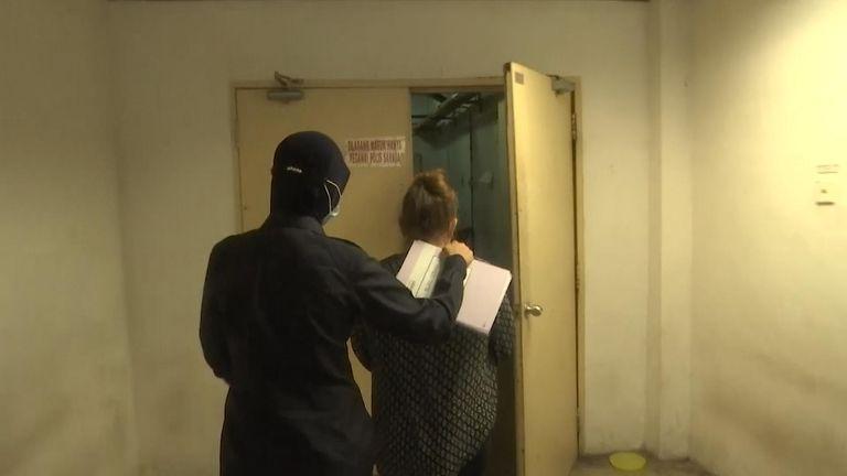 Samantha Jones being taken through court in Malaysia