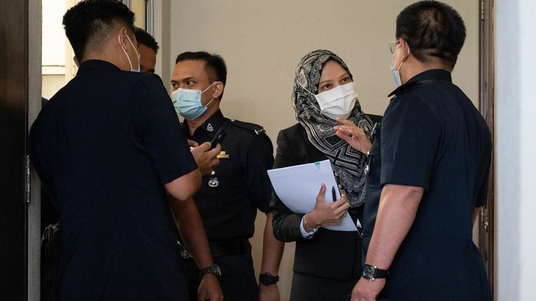 Members of the Royal Malaysia Police arrive at a court for the inquest on Monday
