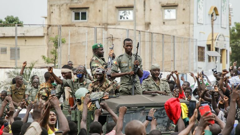 The crowds celebrated as rebel troops seized the president and prime minister