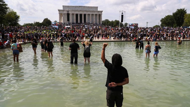 "Demonstrators stand in the waters of the Lincoln Memorial reflecting pool as they listen to the families of people killed in interactions with police during the ""Get Your Knee Off Our Necks"" Commitment March on Washington in support of racial justice in Washington, U.S., August 28, 2020. REUTERS/Tom Brenner"
