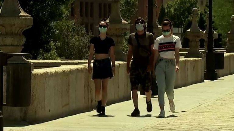 People in Madrid wore masks as the heatwave struck during the coronavirus outbreak