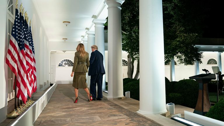 First Lady Melania Trump walks with President Donald Trump after her speech