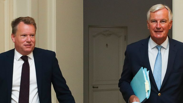 Britain's chief negotiator David Frost (L) and EU's Brexit negotiator Michel Barnier arrive for a working breakfast after the seventh round of talks