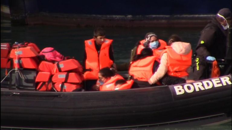 Migrants being rescued by coastguards