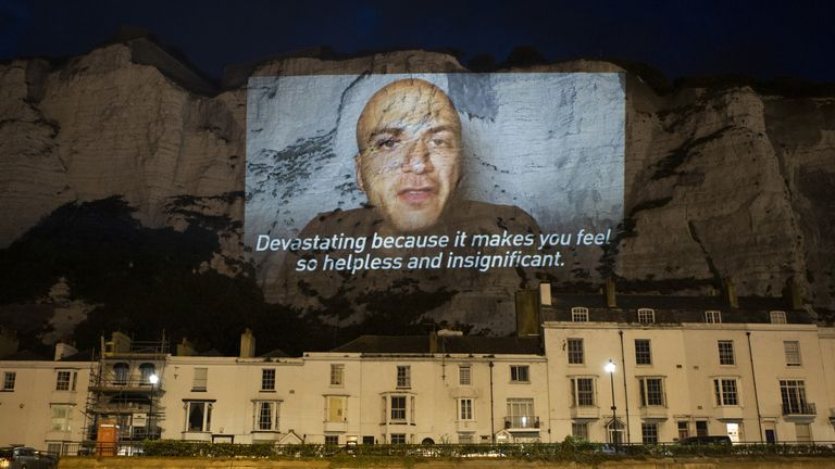 Hassan Akkad's face was projected onto the White Cliffs of Dover