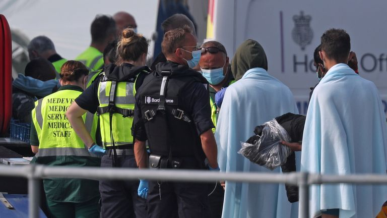 A group of people thought to be migrants are brought into Dover by Border Force officers