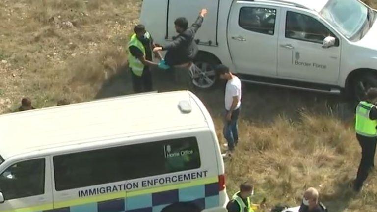 Border Force representatives meet migrants at Kingsdown in Kent
