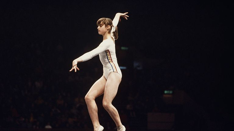 Nadia Comaneci of Romania performs her routine on the Balance Beam during the Women's ArtisticTeam all-around event on 19 July 1976 during the XXI Olympic Summer Games at the Montreal Forum, Montreal, Canada. (Photo by Don Morley/Getty Images) )