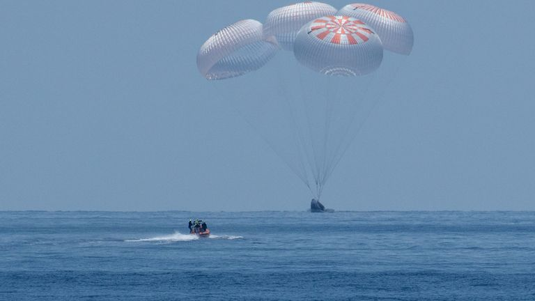The spacecraft was guided down by four parachutes