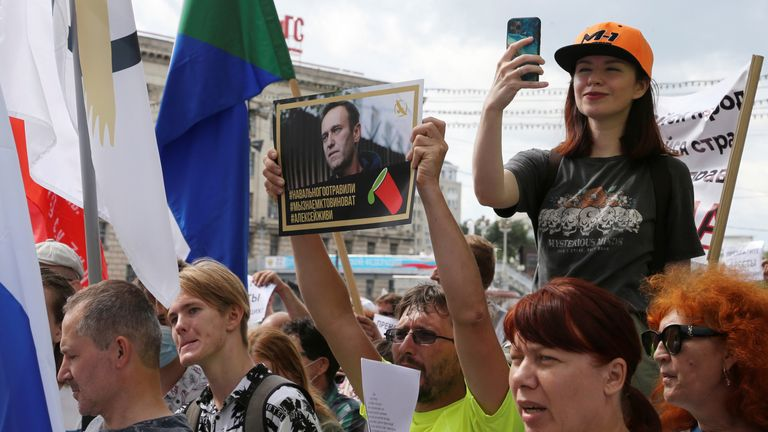 """An anti-Kremlin protester's poster reads: """"Navalny was poisoned. We know who is guilty. Alexei, live"""""""