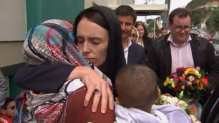 New Zealand Prime Minister Jacinda Ardern consoles a woman after the 2019 Christchurch mosque shooting.