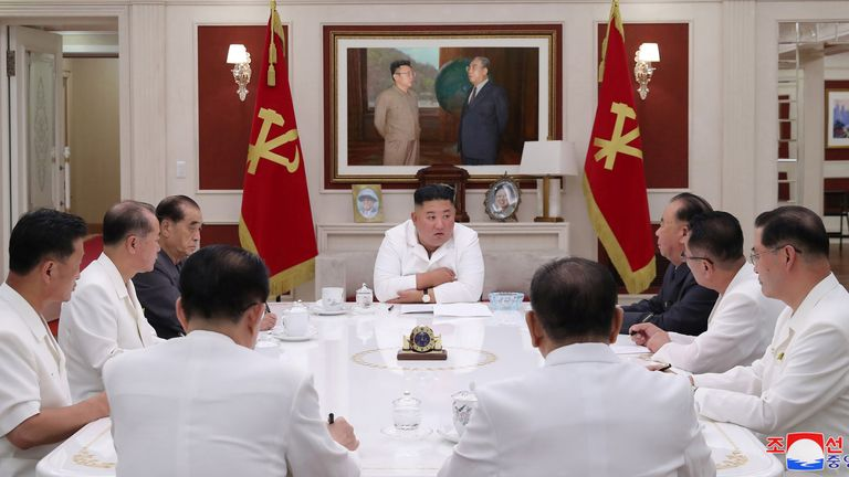 North Korean leader Kim Jong Un  spearheads a meeting with officials