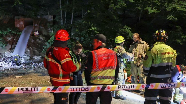 Emergency personnel are seen at the site of an illegal rave in Oslo, Norway