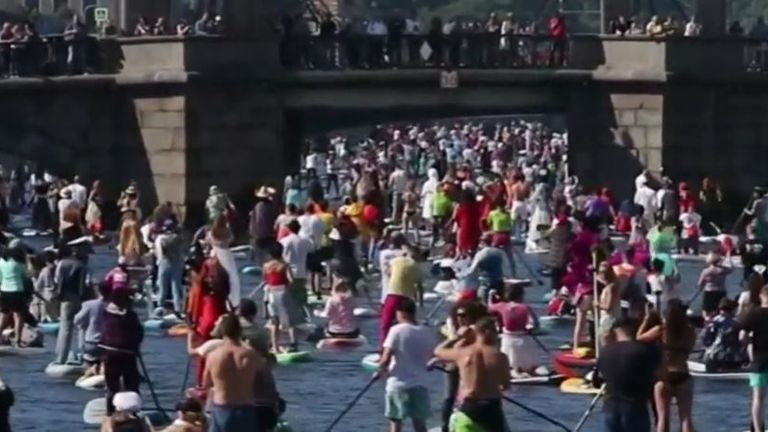 Thousands of paddleboarders take to the water in St Petersburg