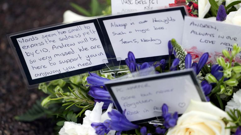 A floral tribute was laid during a memorial service at Newbury Police Station