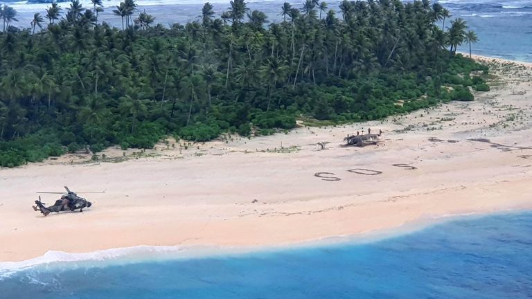 A military helicopter lands on Pikelot Island after the missing men's SOS message is spotted on the beach. Pic: Australian Defence Force