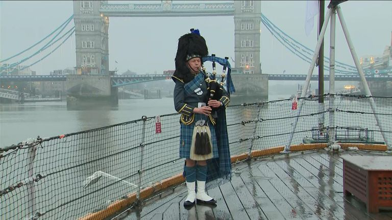 A piper on board HMS Belfast in central London