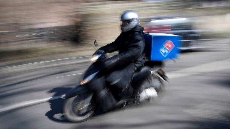 A Dominoes pizza delivery driver