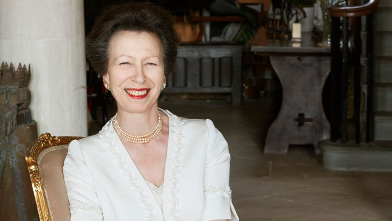 Princess Anne smiled as she wore a flowing evening dress