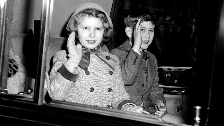 Princess Anne and Prince Charles waving at the crowds in London in 1958