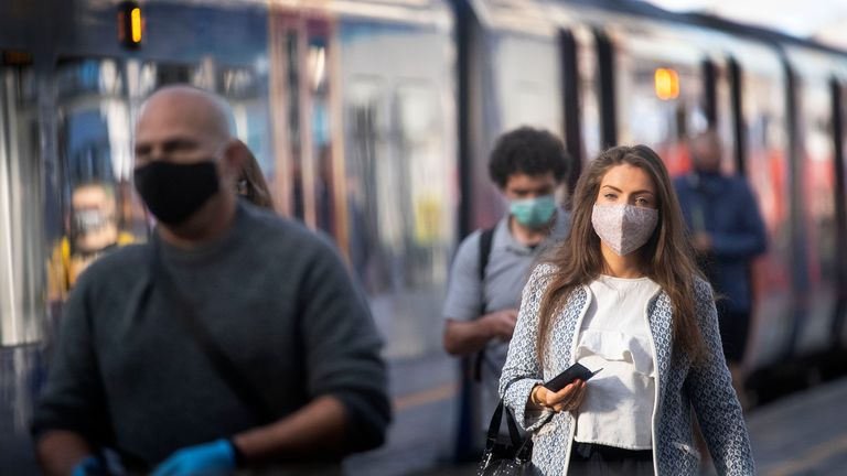 Passengers wearing face masks at Waterloo station in London as face coverings become mandatory on public transport in England 15/6/2020