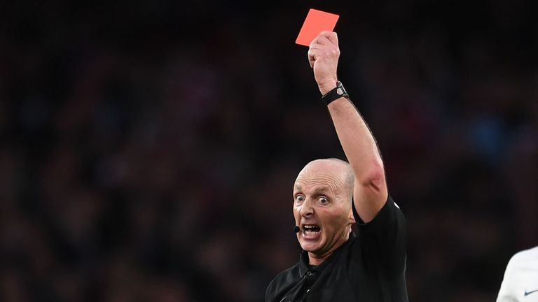 A red card is issued during a Premier League match